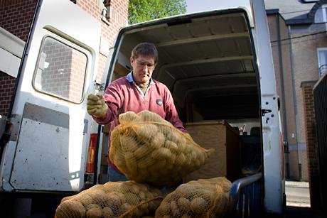 Unloading patatoes, Lamur, Belgium, 2009.
