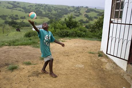 Boy with ball, Mbabane, Swaziland, 2005.