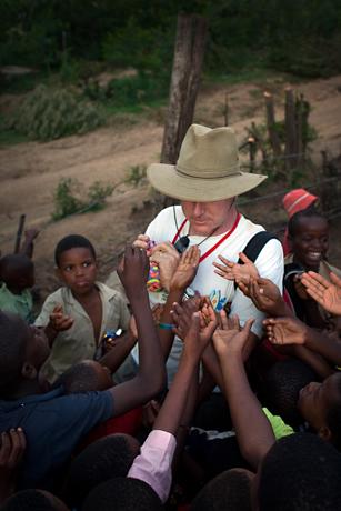 Orphans grabbing for trinkets, Mbabane, Swaziland, 2005.